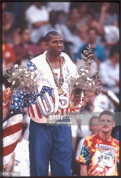 Magic Johnson of Team USA the Dream Team on the victor's podium after winning the gold medal in the men's basketball competition at the 1992 Summer...