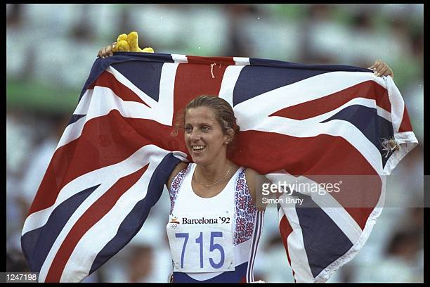 Sally Gunnell of Great Britain celebrates her gold medal in the 400m Hurdles at the summer olympics held in the Montjuic Stadium in Barcelona Spain...