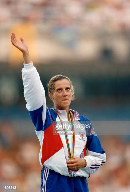 Sally Gunnell of Great Britain waving happily after receiving the gold medal for the 400 Metres hurdle event at the 1992 Olympic games in Barcelona...