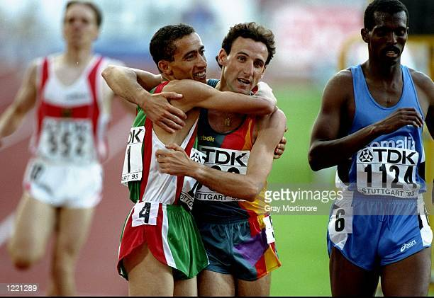Noureddine Morceli of Algeria celebrates his victory with Fermin Cacho of Spain after the 1500 metres event during the World Championships at the...