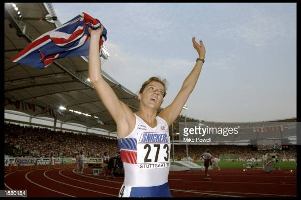 Sally Gunnell of Great Britain celebrates after her victory in the 400m hurdles and breaking the world record with a time of 5274 seconds during the...