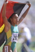 Cathy Freeman of Australia celebrates after she wins the 400 metres final during the Commonwealth Games in Victoria Canada Freeman won the gold medal...