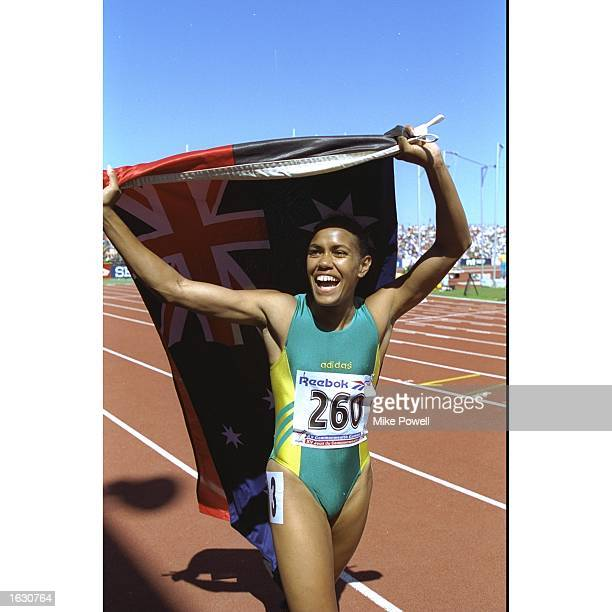 Cathy Freeman of Australia celebrates after winning the 200 and 400 metres events at the Commonwealth Games in Victoria Canada Freeman won the gold...