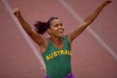 Cathy Freeman of Australia celebrates after winning the 400 metres final during the Commonwealth Games in Victoria Canada Freeman won the gold medal...