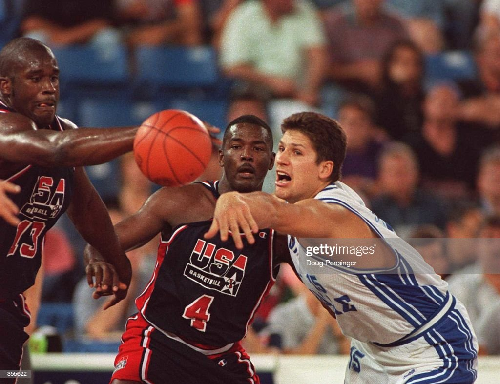 SHAQUILLE O NEAL AND JOE DUMARS OF THE USA DREAM TEAM BATTLE WITH