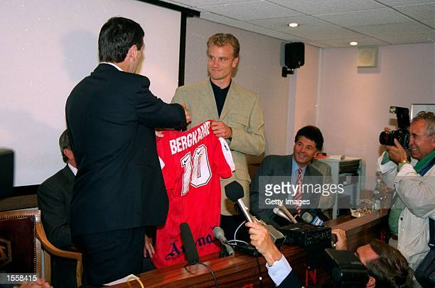 Dennis Bergkamp shakes manager Bruce Rioch by the hand after signing for Arsenal at Highbury in London Mandatory Credit Allsport UK /Allsport