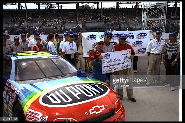 Jeff Gordon celebrates after registering the fastest qualifing time for the NASCAR Brickyard 400 at Indianapolis Motor Speedway in Speedway Indiana...