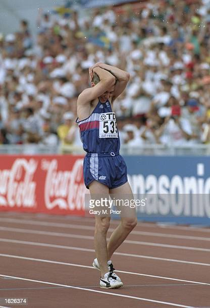 Jonathan Edwards walks on the track holding his head in disbelief after setting a new World Record in the Triple Jump event with a jump of 1829...