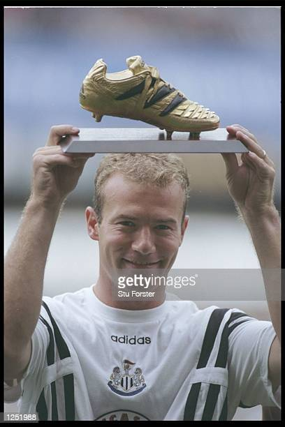 Alan Shearer of Newcastle United holds aloft the golden boot which he recieved for being top scorer in the European Nations Championships prior to...