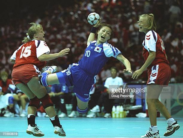 Sang Ok Oh of Korea takes at shot a goal during the match against Denmark at the Georgia World Congress at the 1996 Centennial Olympic Games in...