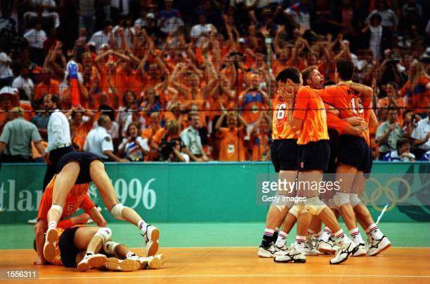 The Dutch team celebrate their gold medal win over Italy during the mens Volleyball final at the Olympic Games at the Omni Coliseum in Atlanta...