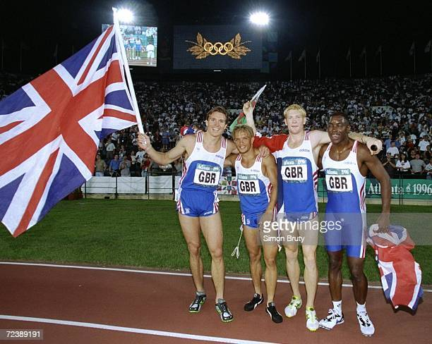 The Great Britain 4 X 400 relay team of L to R Roger Black Jamie Baulch Iwan Thomas and Mark Richardson celebrate their silver medals at the Olympic...