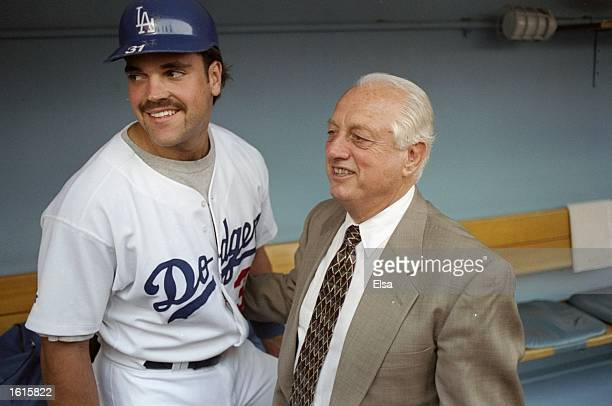 Former manager Tommy Lasorda and catcher Mike Piazza of the Los Angeles Dodgers pose together for a picture during the retiring of Lasorda's number...