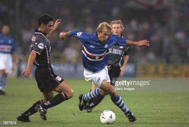 Jurgen Klinsmann of Sampdoria takes on the Vicenza defence during the Serie A match at the Luigi Ferrari Stadium in Sampdoria Italy Mandatory Credit...