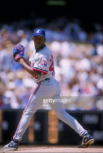 Pitcher Pedro Martinez of the Montreal Expos winds up to throw a pitch during the Expos 10 loss to the Los Angeles Dodgers at Dodger Stadium in Los...