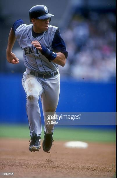 Alex Rodriguez of the Seattle Mariners runs from second base to third base during a game against the New York Yankees at Yankee Stadium in the Bronx...