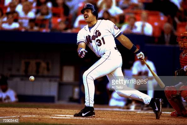 Catcher Mike Piazza of the New York Mets reacts after hitting a ball off of his chest during a game against the St Louis Cardinals at Shea Stadium in...