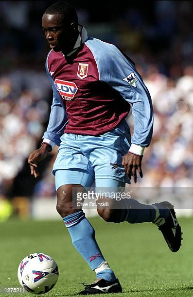 Dwight Yorke of Aston Villa in action against Everton in the FA Carling Premiership at Goodison Park in Liverpool England The score was Everton 00...