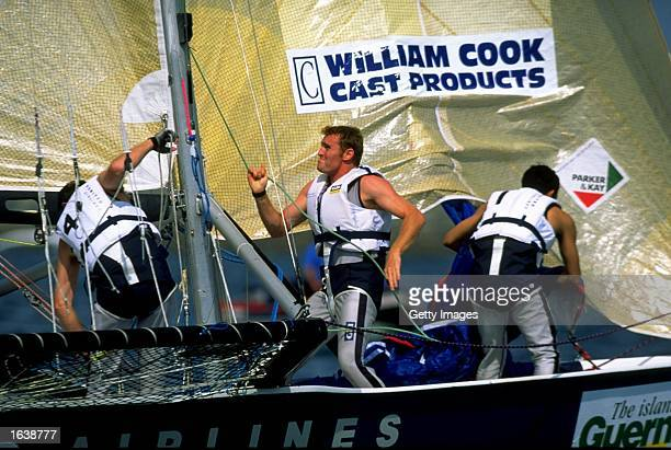 Hoisting the spinnaker on United Airlines during Round 3 of the Ultra 30 Grand Prix Series off Guernsey in the Channel Islands Photo Graham Snook...
