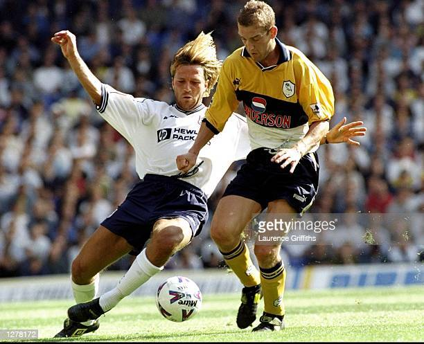 Paolo Tramezzani of Tottenham Hotspurs in a challenge against Andy Booth of Sheffield Wednesday in the FA Carling Premiership match at White hart...