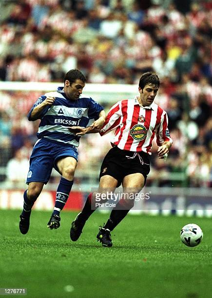 Paul Butler of Sunderland is shadowed by Kevin Gallen of Queens Park Rangers during a Nationwide Division One match at the Stadium of Light in...