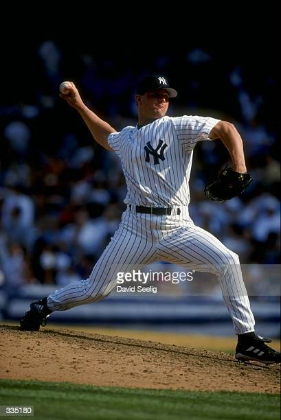 Pitcher Mark Clark of the New York Yankees throws during the game against the Texas Rangers at Yankee Stadium in Bronx New York The Rangers defeated...