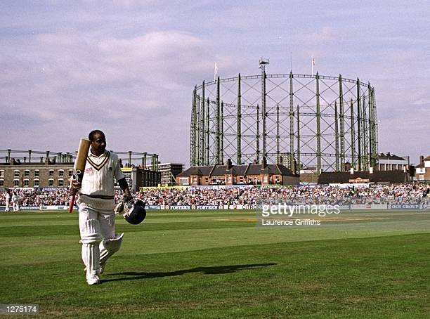 Sanath Jayasuriya of Sri Lanka walking back to the pavillion after scoring a double century during the test match against England at the Oval in...