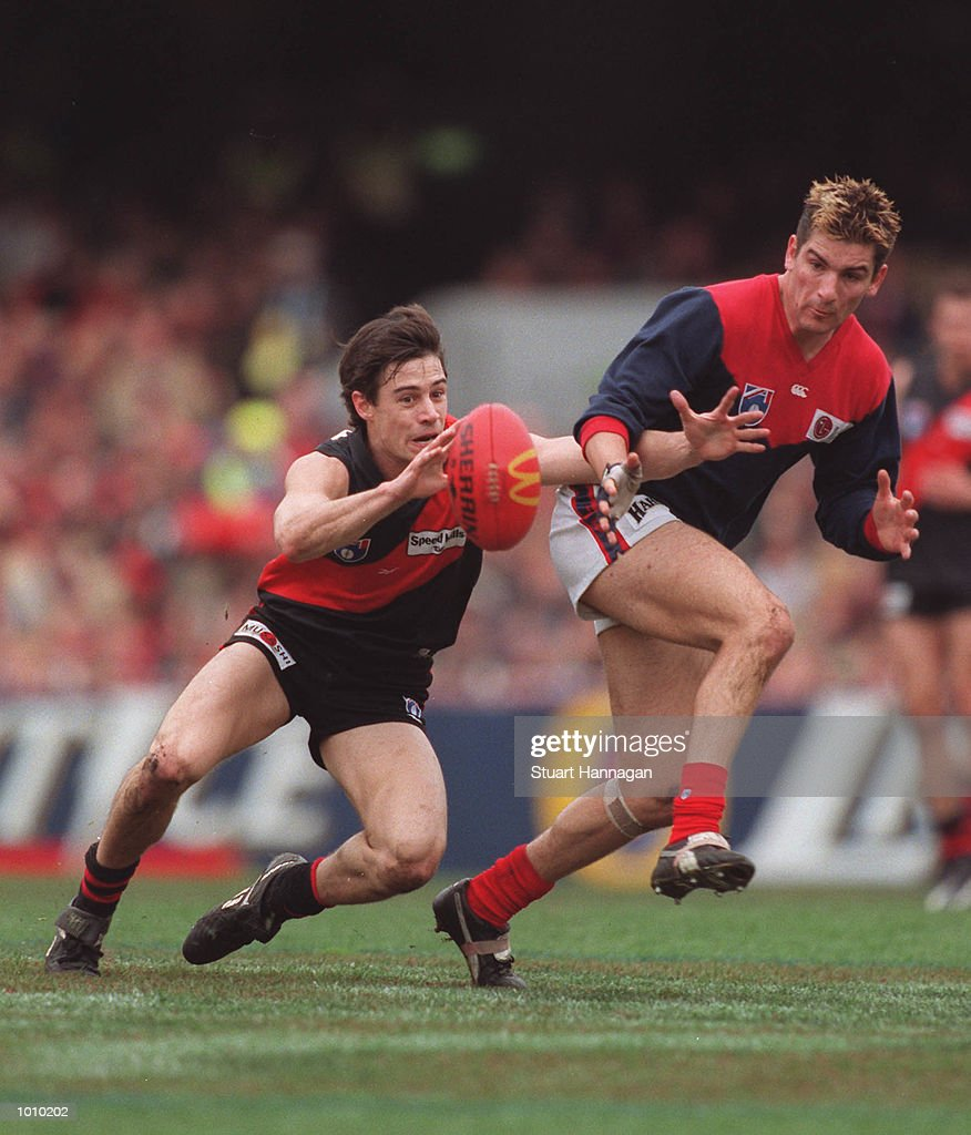 Blake Caracell #33 for Essendon controls the football in front of Adem Yze # 13 for Melbourne during the AFL round 22 game Melbourne v Essendon at the MCG,Melbourne,Victoria,Australia Essendon defeated Melbourne. Mandatory Credit: Stuart Hannagan/ALLSPORT