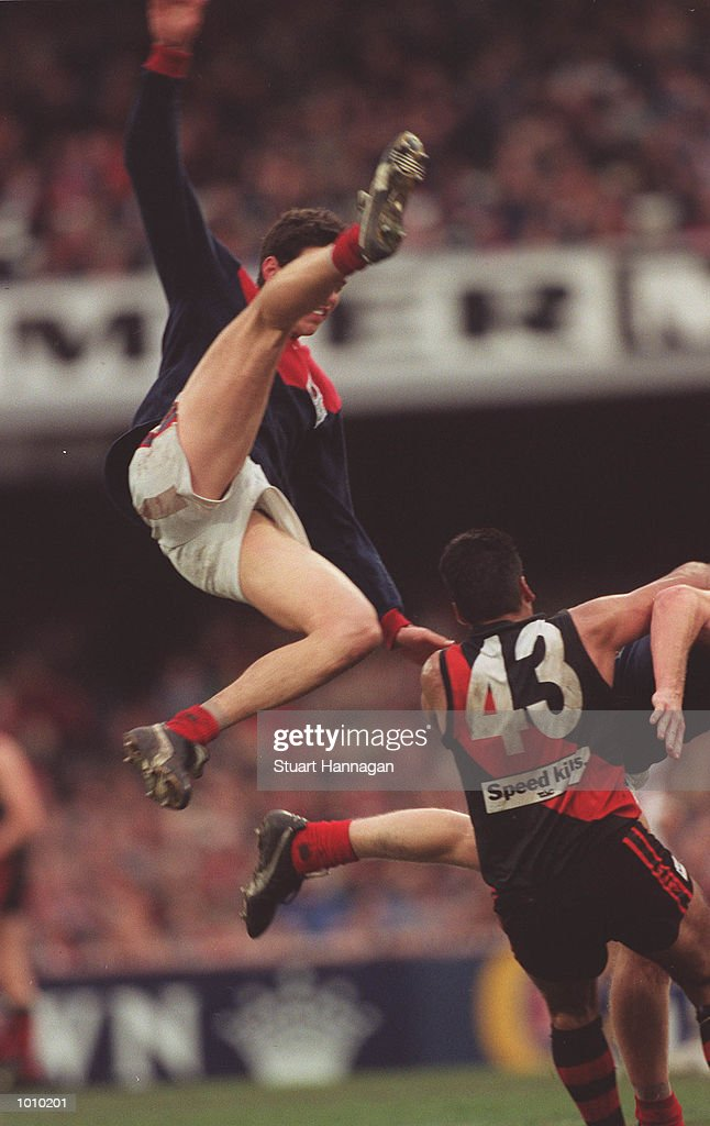 Brent Grgic #4 for Melbourne flies high over Dean Rioli # 43 for Essendon during the AFL round 22 game Melbourne v Essendon at the MCG,Melbourne,Victoria,Australia Essendon defeated Melbourne. Mandatory Credit: Stuart Hannagan/ALLSPORT