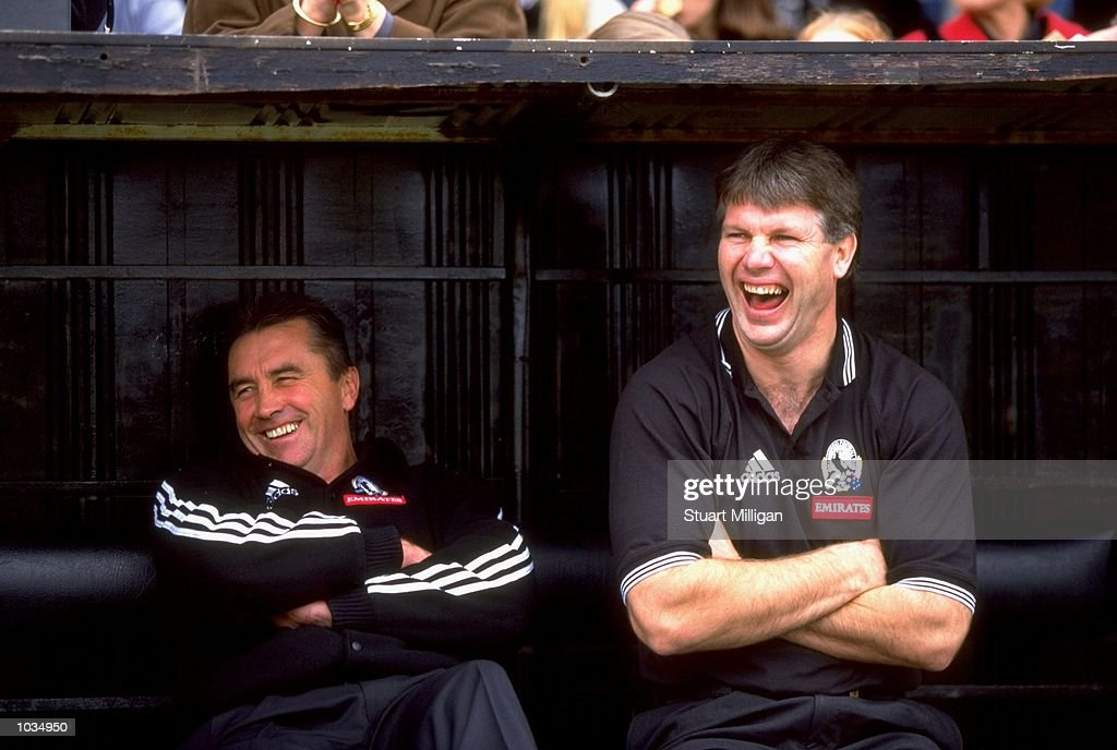 Collingwood coach Tony Shaw and Danny Frawley share a joke during the AFL Round 22 game at Victoria Park in Collingwood Victoria Australia The Lions...