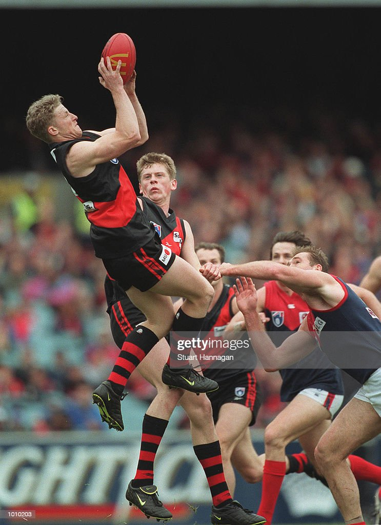 Damien Hardwick # 11 for Essendon takes a high mark over team mate Mark Bolton# 23 and David Neitz # 9 for Melbourne during the AFL round 22 game Melbourne v Essendon at the MCG,Melbourne,Victoria,Australia.Essendon defeated Melbourne. Mandatory Credit: Stuart Hannagan/ALLSPORT
