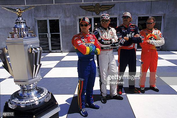Drivers Jeff Gordon Dale Earnhardt Dale Jarrett and Ricky Rudd pose with the trophy during the Brickyard 400 part of the NASCAR Winston Cup Series at...