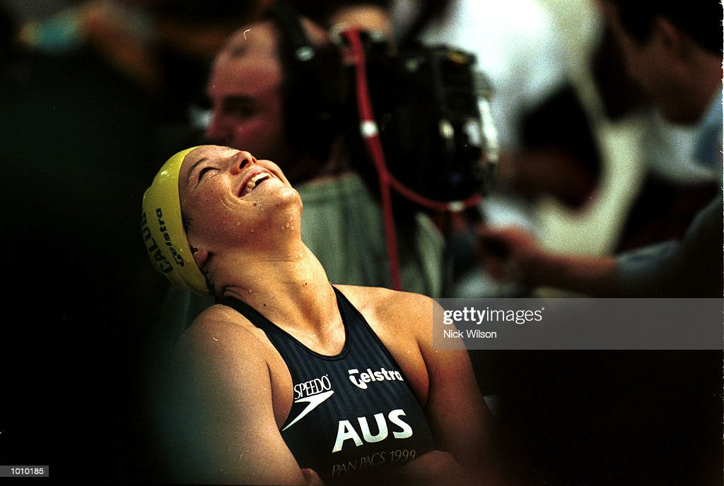 Dyana Calub of Australia expresses surprise and delight as she shares the gold medal in a dead heat with Mai Nakamura of Japan in the womens 100 metres backstroke during day three of the Pan Pacific Swimming Championships at the Aquatic Centre, Homebush, Sydney, Australia. Mandatory Credit: Nick Wilson/ALLSPORT