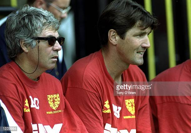 Egil Olsen the manager of Wimbledon on the bench with his coach Mick Harford during the FA Carling Premiership match against Watford played at...