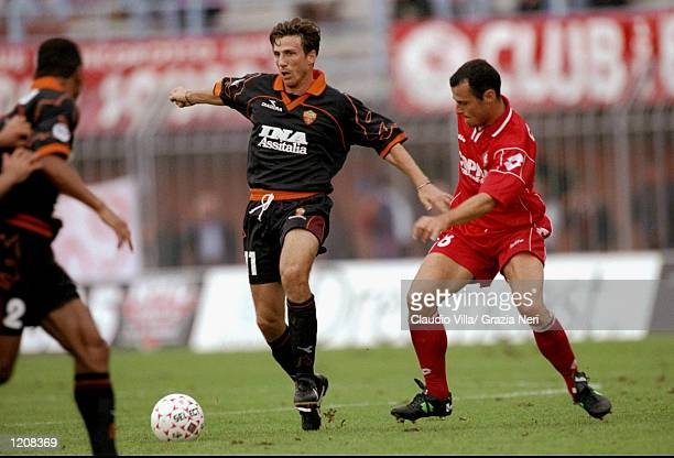 Eusebio Di Francesco of Roma holds off Paolo Cristallini of Piacenza during the Serie A match at the Stadio Galleana in Piacenza Italy Mandatory...