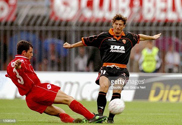 Eusebio Di Francesco of Roma is challenged by Cleto Polonia of Piacenza during the Serie A match at the Stadio Galleana in Piacenza Italy Mandatory...