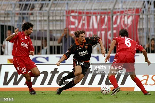 Eusebio Di Francesco of Roma takes on Stefano Sacchetti and Alessandro Lucarelli of Piacenza during the Serie A match at the Stadio Galleana in...