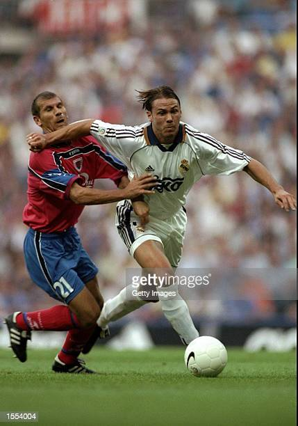 Fernando Redondo of Real Madrid shrugs off Batiles Barbu of Numancia during the Spanish Primera Liga match at the Santiago Bernabeu Stadium in Madrid...