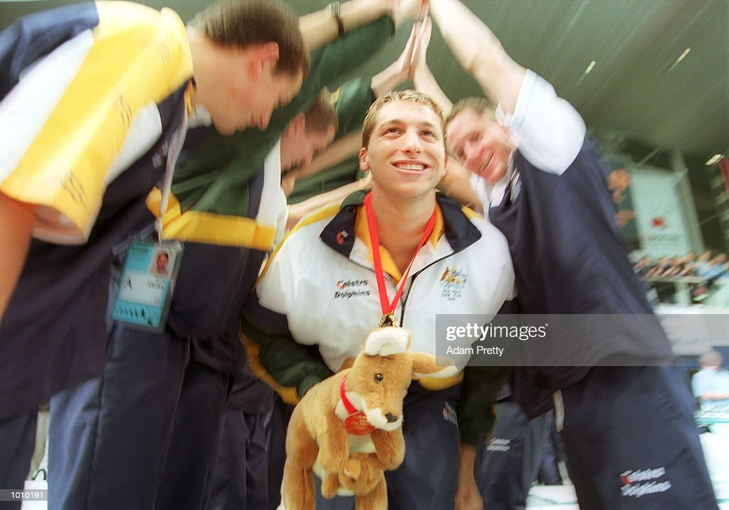 Ian Thorpe of Australia is congratulated by his team mates after setting a New World Record time of 1 minute 45.7 seconds whilst winning the gold medal in the mens 200 metres freestyle final during day three of the Pan Pacific Swimming Championships at the Aquatic Centre, Homebush, Sydney, Australia. Mandatory Credit: Adam Pretty/ALLSPORT