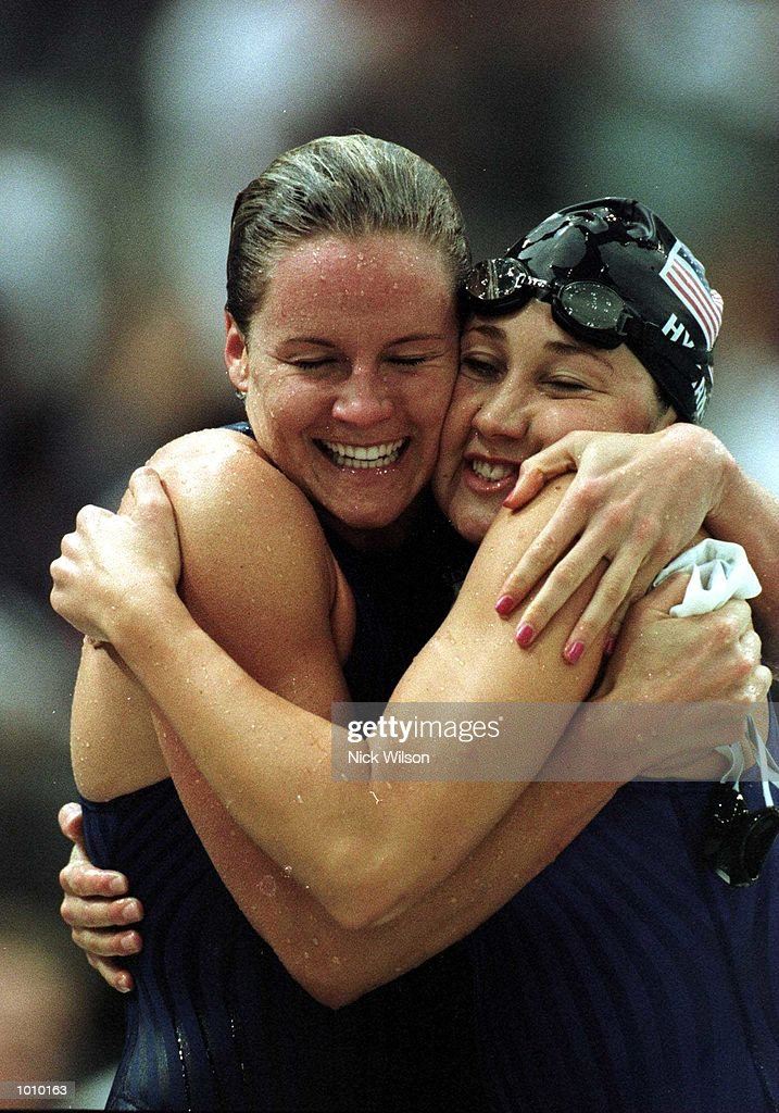 Jenny Thompson of the USA on left celebrates with fellow American Misty Hyman as she sets a New World Record in the womens 100 metres butterfly final with a time of 57.88 seconds during day two of the Pan Pacific Swimming Championships atthe Aquatic Centre, Homebush, Sydney, Australia. Mandatory Credit: Nick Wilson/ALLSPORT