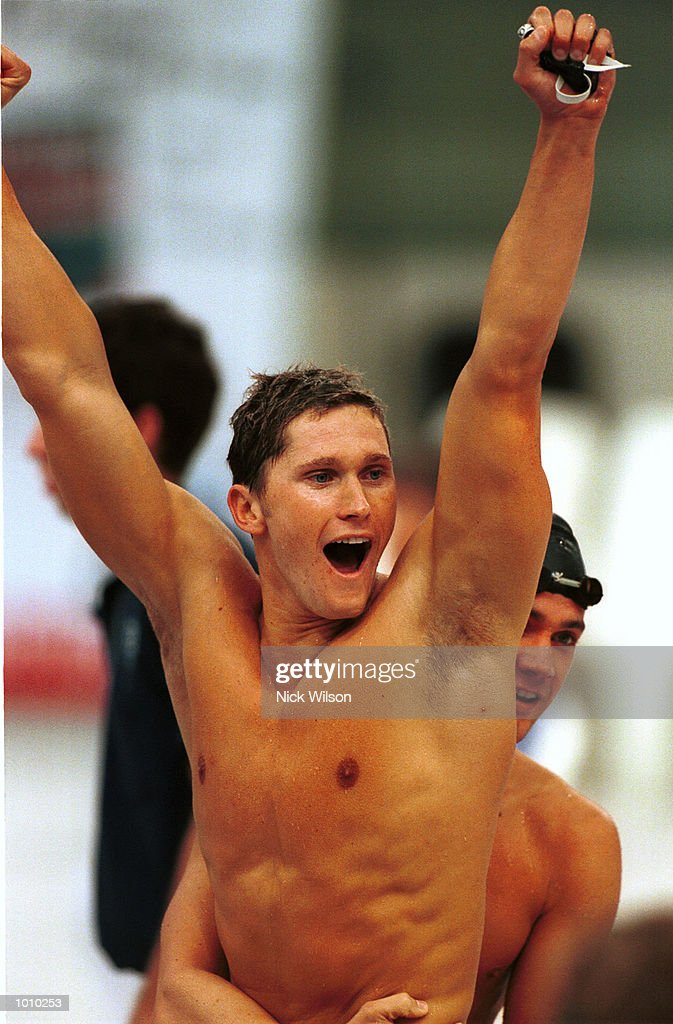 Lenny Krayzelburg of the USA celebrates his teams 4x100 gold medal win in the medley relay during day eight of the Pan Pacific Swimming Championships at the Aquatic Centre, Homebush, Sydney, Australia. Mandatory Credit: Nick Wilson/ALLSPORT