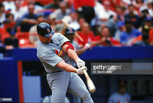 Mark McGwire of the St Louis Cardinals hits his 50th home run during the game against the New York Mets at Shea Stadium in Flushing New York The Mets...