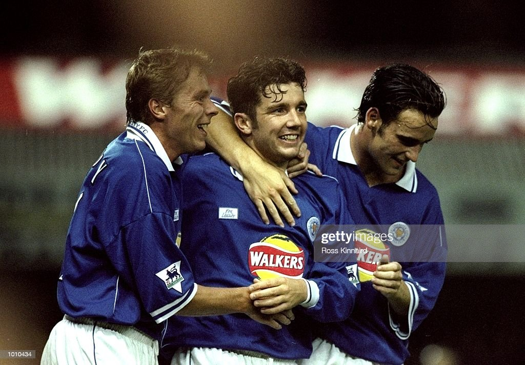 Muzzy Izzet of Leicester City is celebrates with team mates Steve Guppy and Stefan Oakes after scoring against Watford in the FA Carling Premiership match at Filbert Street in Leicester, England. Leicester won 1-0. \ Mandatory Credit: Ross Kinnaird /Allsport