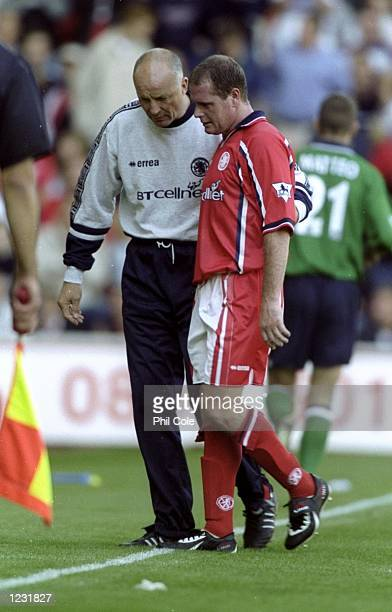 Paul Gascoigne of Middlesbrough limps off with a calf strain during the FA Carling Premiership match against Liverpool at the Riverside Stadium in...