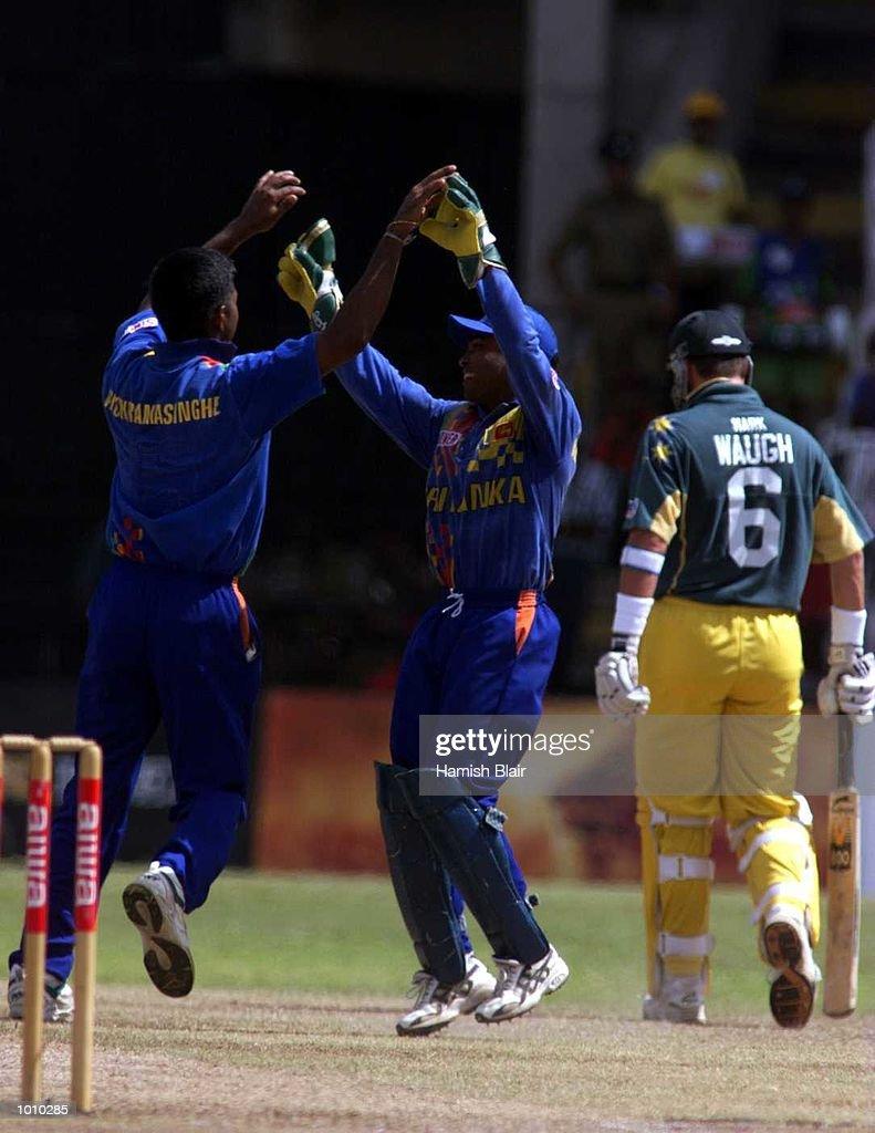 Pramodya Wickremakinghe and Romesh Kaluwitharana of Sri Lanka celebrate the wicket of Adam Gilchrist of Australia, caught out, during the one day Final at Premadasa Stadium, Colombo, Sri Lanka. Mandatory Credit: Hamish Blair/ALLSPORT