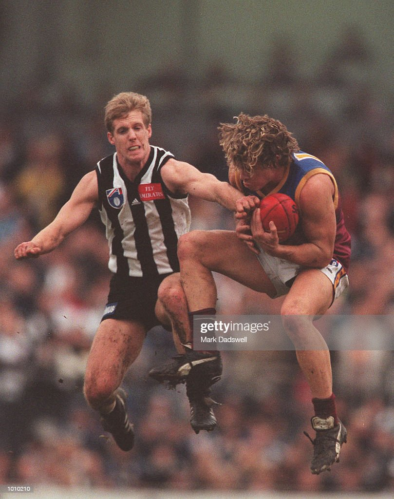 Steven Lawrence # 15 for Brisbane takes a mark in front of Stephen Patterson # 6 for Collingwood during the AFL round 22 game Collingwood v Brisbane at Victoria Park Collingwood,Victoria,Australia.Brisbane defeated Collingwood. Mandatory Credit: Mark Dadswell/ALLSPORT
