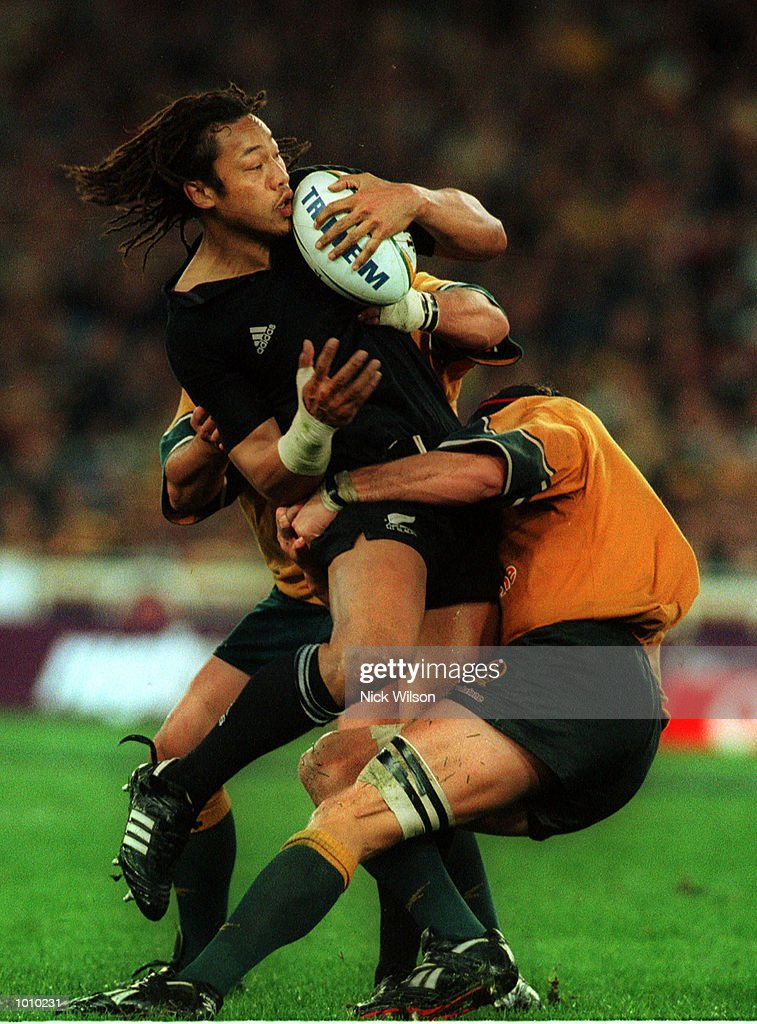 Tana Umaga of New Zealand is tackled by Mark Conners of Australia in front of a new world record crowd of 108,000 for a rugby union international during the Bledisloe Cup game between Australia and New Zealand at Stadium Australia, Homebush, Sydney, Australia. Australia won 28-7. Mandatory Credit: Nick Wilson/ALLSPORT