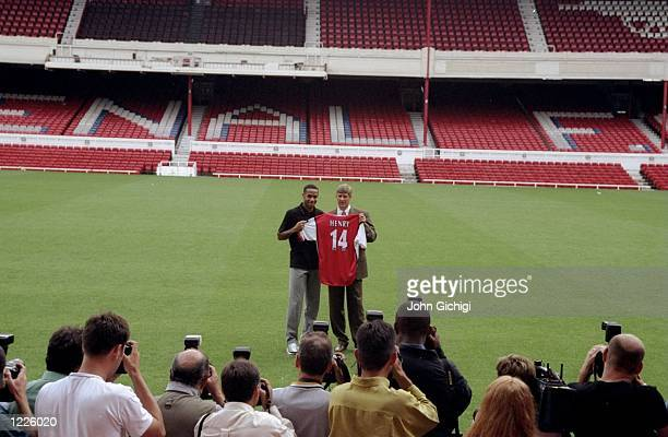 Thierry Henry signs for Arsenal Football Club and is presented to the media by his new manager Arsene Wenger during a photocall held at Highbury in...