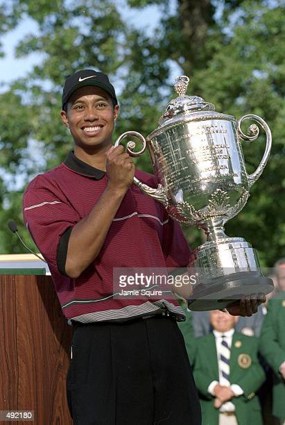 Tiger Woods hoists the Wanamaker Trophy after capturing the PGA Championship at Medinah Country Club in Medinah Illinois Mandatory Credit Jamie...