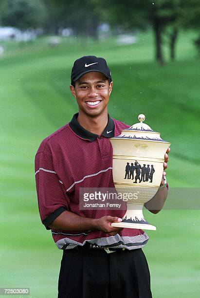 Tiger Woods poses with his trophy after the NEC Invitational World Golf Challenge at the Firestone Country Club in Akron Ohio Mandatory Credit Jon...